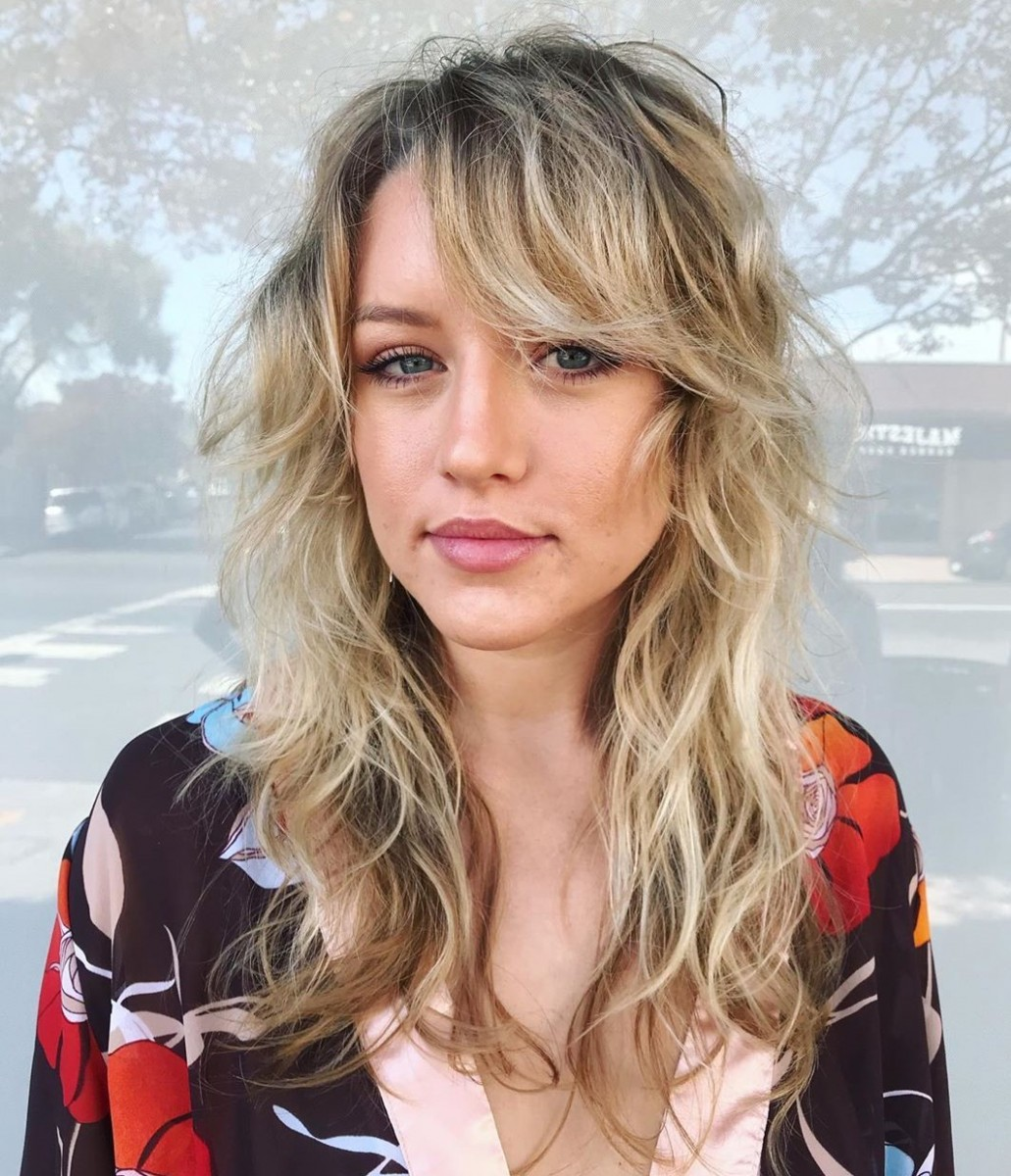12 Trendy Haircuts And Hairstyles With Bangs In 12 Hair Adviser Side Swept Bangs Curly Hair