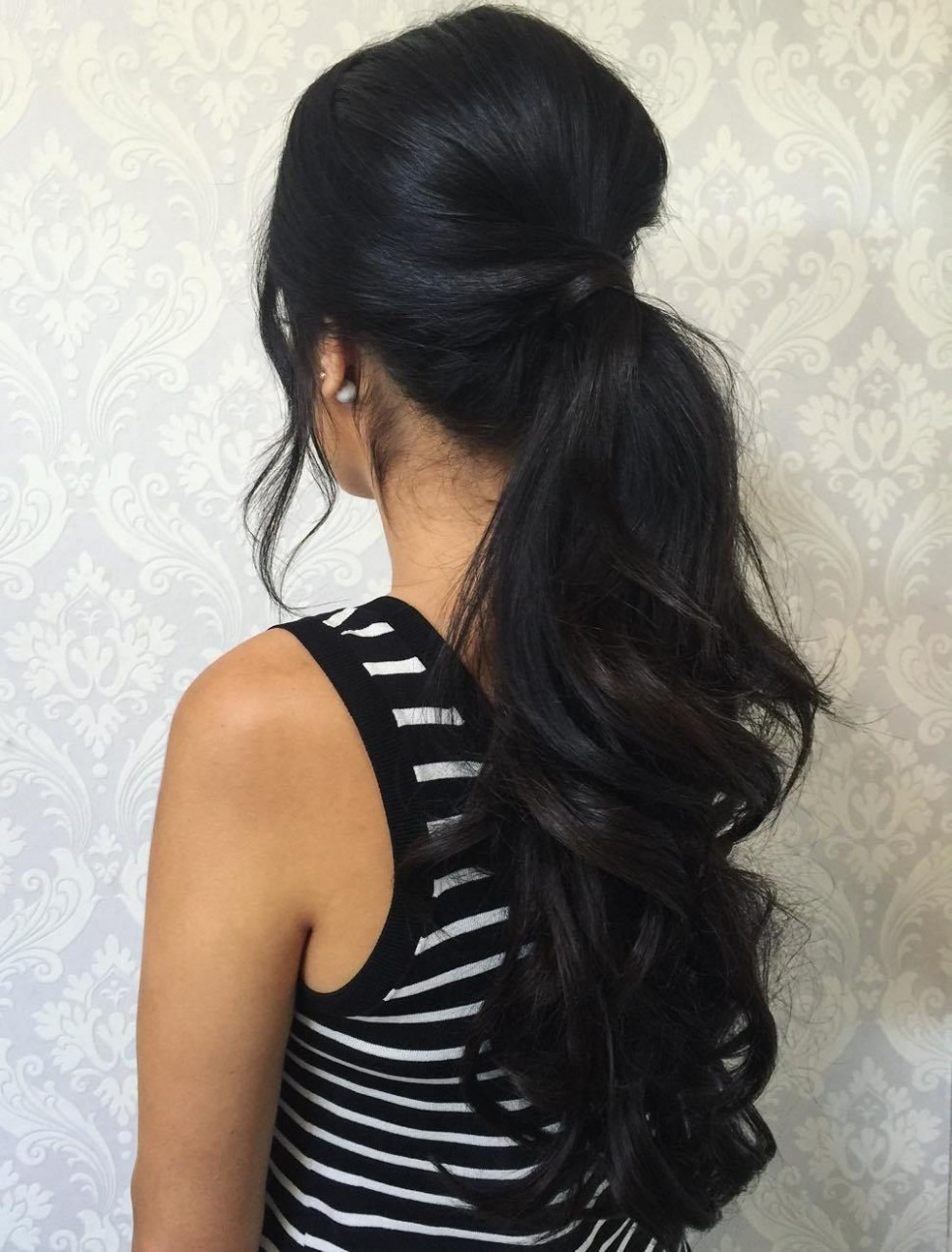 9 Eye Catching Ways To Style Curly And Wavy Ponytails Low Ponytail Curly Hair