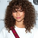 Can I Get Bangs With Curly Hair? A Hairstylist Breaks Down The Girls With Curly Hair And Bangs