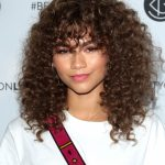 Can I Get Bangs With Curly Hair? A Hairstylist Breaks Down The Side Bangs Curly Hair