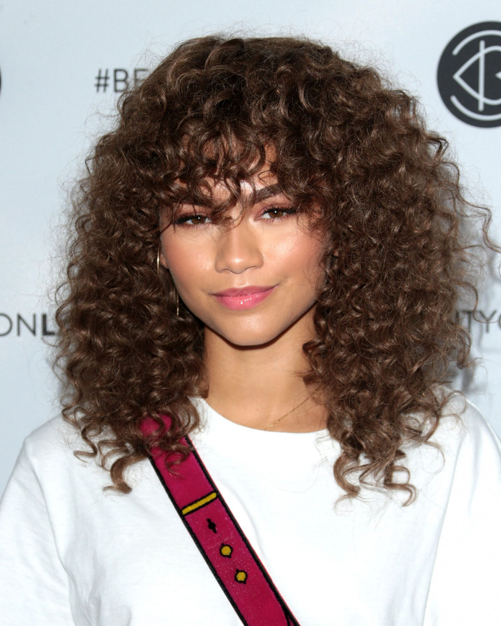 Can I Get Bangs With Curly Hair? A Hairstylist Breaks Down The