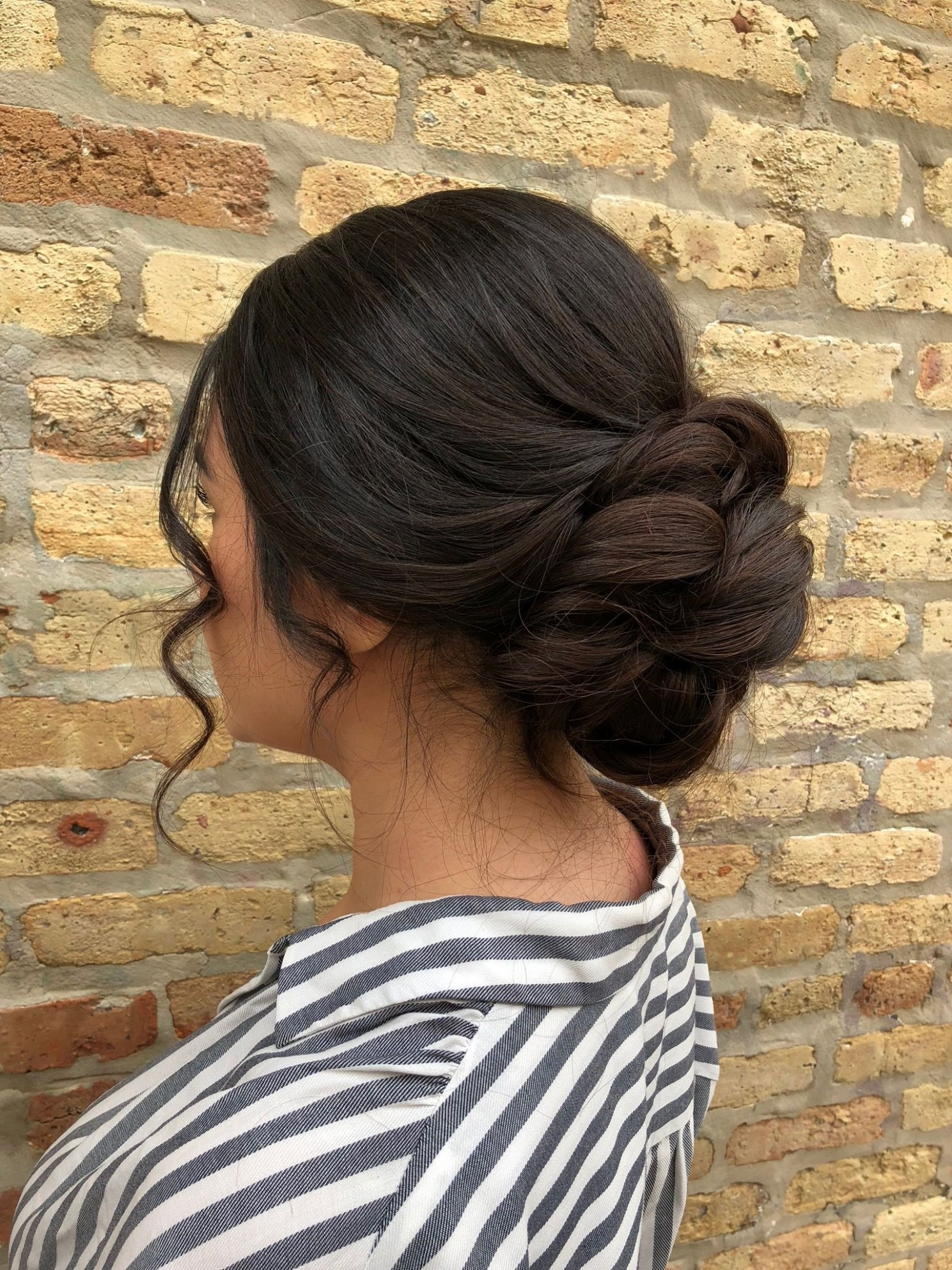 Elegant Swept Back Updo With Low Bun Curly Face Framing Pieces Low Curly Bun