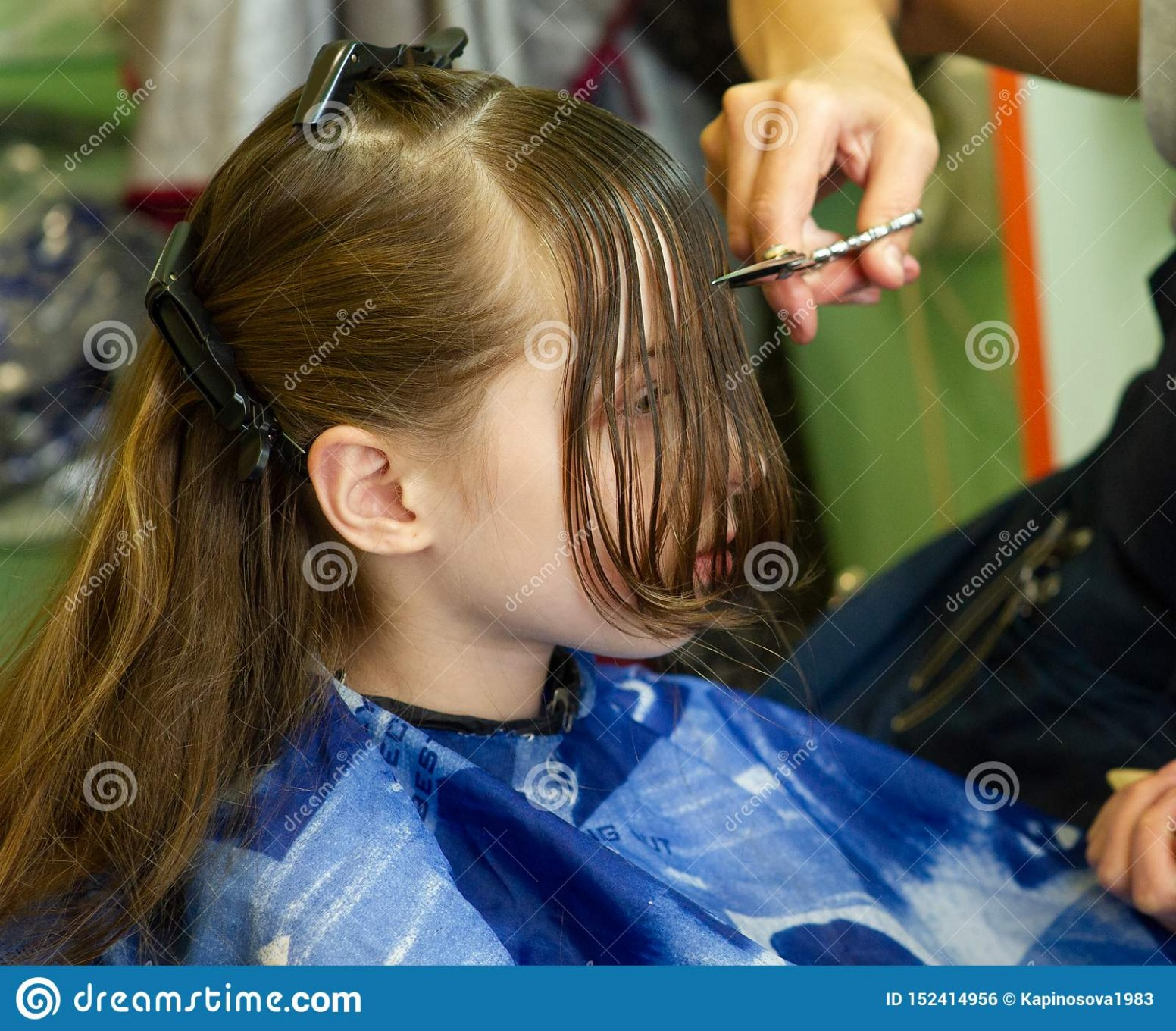 Hairdresser Making A Hair Style To Cute Little Girl Stock Photo