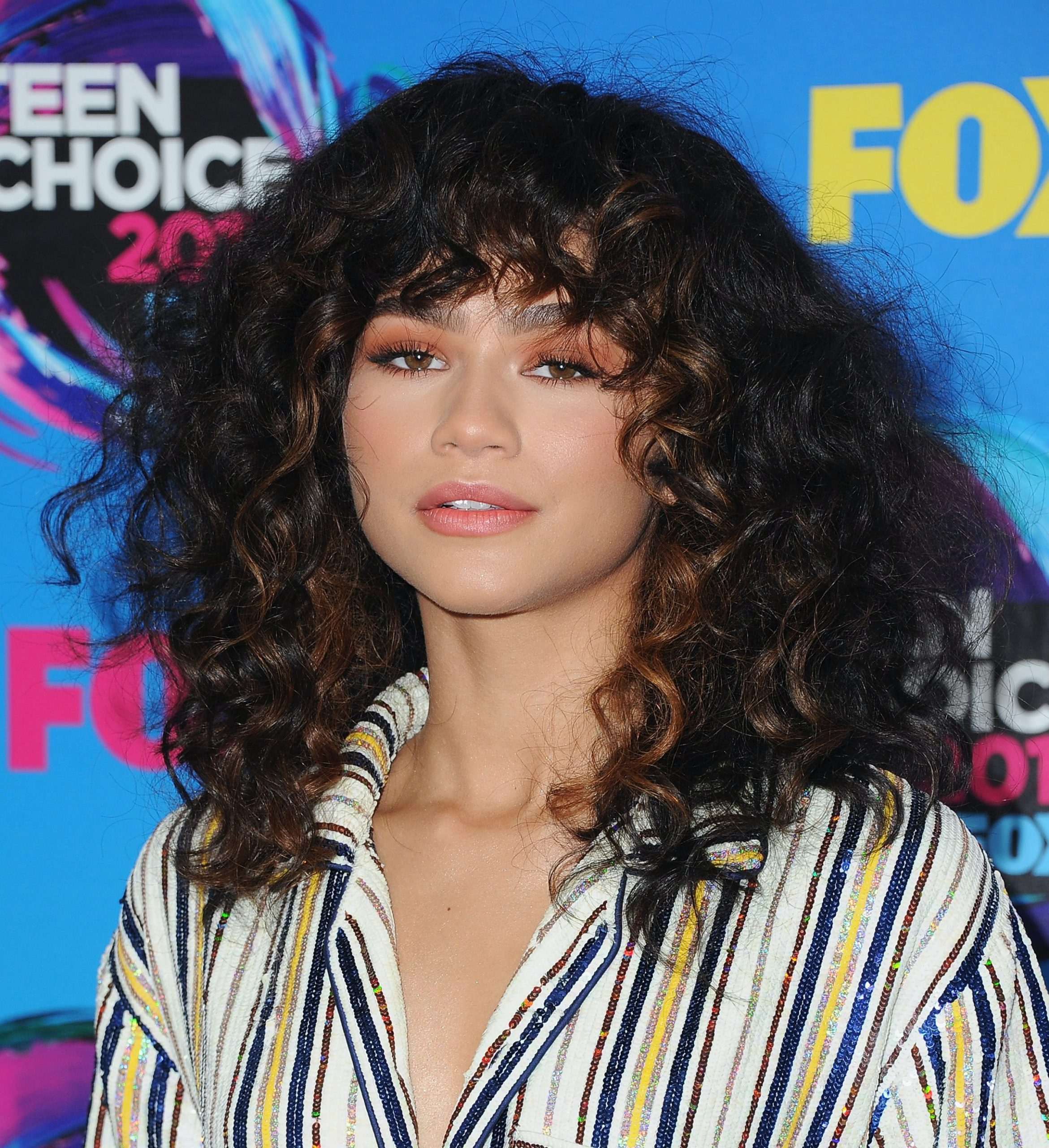 How To Style Curly Bangs - PureWow