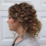 Low Curly Bun With Loose Curls In 11 Curly Hair Styles Low Curly Bun