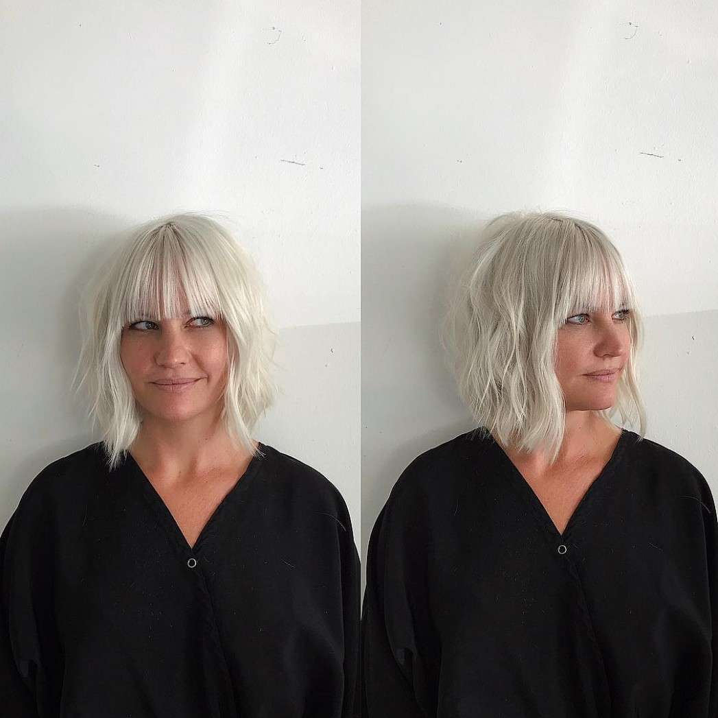 Modern Platinum Angled Bob with Wavy Texture and Bangs - The