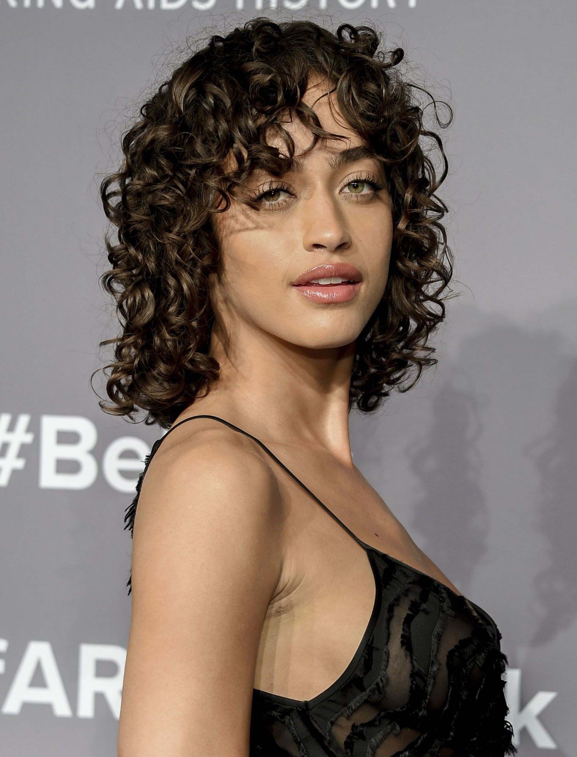 See how to style curly hair and bangs the A-list way