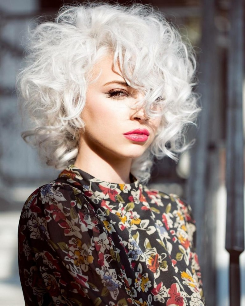 Sexy Platinum Mod Bob With Allover Messy Curly Texture And Long Curly Side Swept Bangs