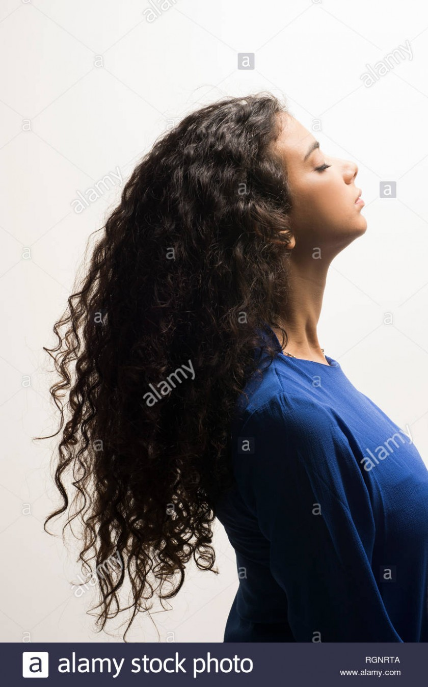 Side View Of A Young Woman With Long Curly Hair Stock Photo Alamy Side Curly Hair