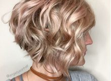Wavy inverted bob with a hint of pink  Hair styles, Wavy bob