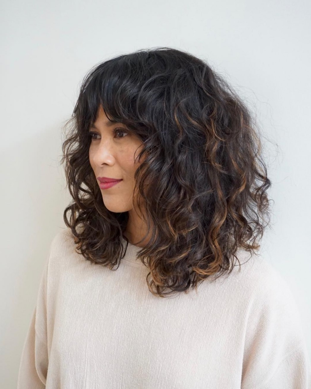 Whether You Want Trendy, Blunt And Polished, Textured With Bangs Curly Lob With Bangs